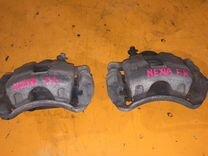 Суппорт тормозной левый на Daewoo Nexia