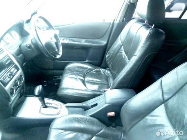 Mazda 323 2003 — фотография №3
